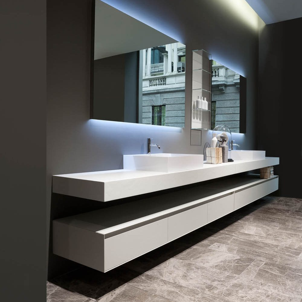set of two sinks with mirror on grey wall