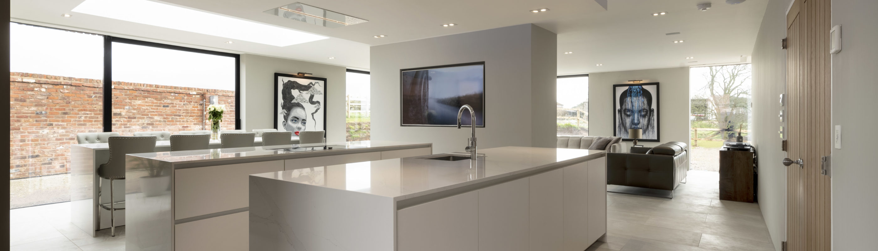 open space white kitchen with marble stone white island