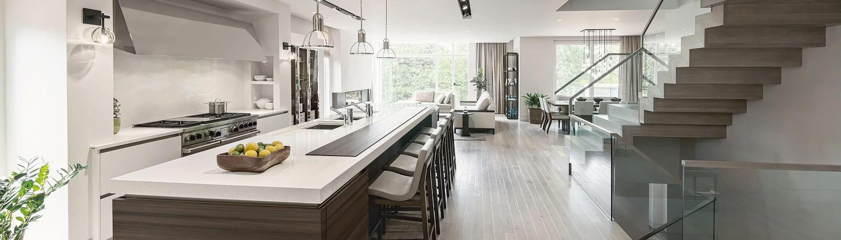 Wide angle of open white kitchen with centre island